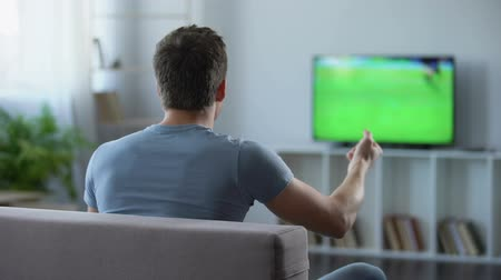 lelkesedés : Football supporter actively cheering his favourite team, disappointed with game Stock mozgókép