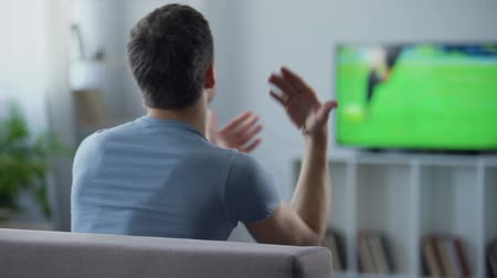entusiasmo : Football fan nervous watching dangerous moment in qualifier match, competition