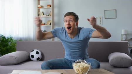 world cup : Excited soccer fan happy for favourite football team winning tournament cup Stock Footage
