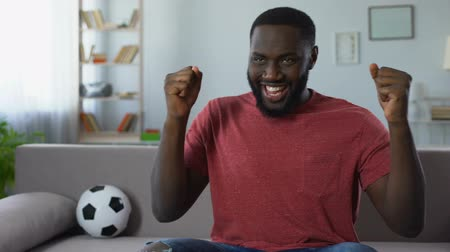 world cup : African-american man dancing victoriously, celebrating victory of football team Stock Footage