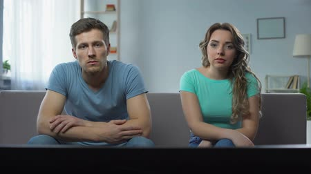 reconcile : Couple in conflict watching tv silently ignoring each other, relationship crisis Stock Footage