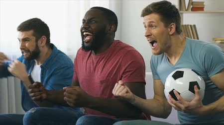 roaring : Friends watching football game final match, burst out roaring after scored goal Stock Footage