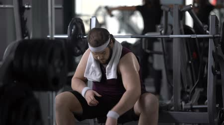 ivászat : Obese male drinking water after barbell exercise, restoring aqua balance, diet