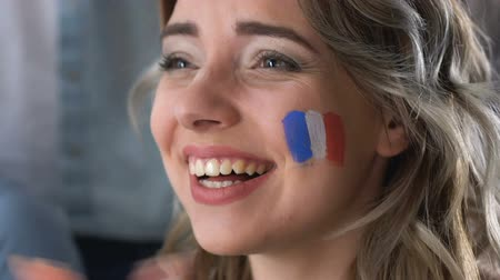 rejoice : Female France fan watching football match, celebrating goal, supporting team