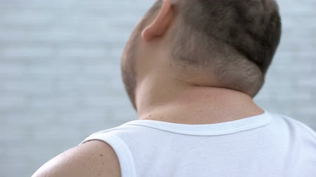 scoliosis : Obese male feeling neck ache stretching muscles, spinal sickness, health problem Stock Footage