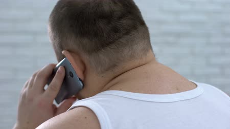 scoliosis : Fat man talking on phone and massaging neck, feeling pain, body care, medicine