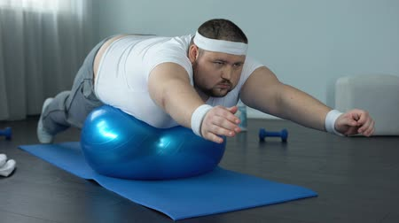 diligence : Obese hardworking man practicing static exercise, strength training program