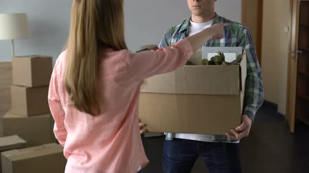 jealous : Angry and offended woman expelling man with all stuff out of house, break-up Stock Footage
