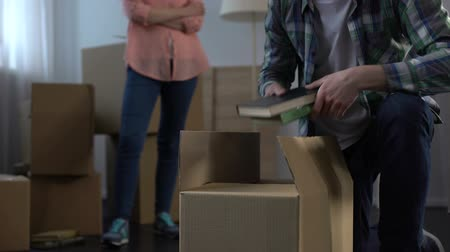 divorcement : Wife nervously waiting while her unfaithful spouse taking things and moving out Stock Footage