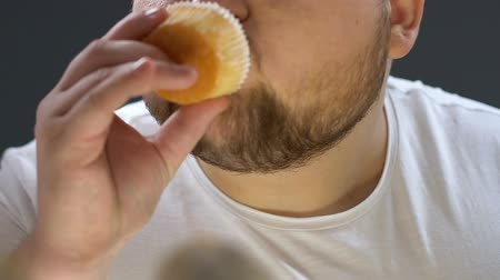 overweight : Obese addicted man opening fridge, eating delicious whipped cream on top of cake Stock Footage