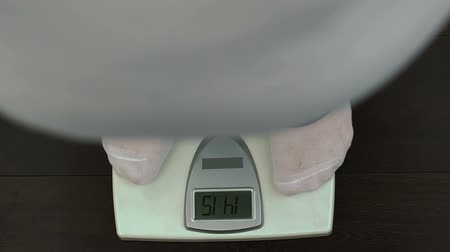 kilogramm : Excess weight man standing on scale, weight loss control, diet result, nutrition.