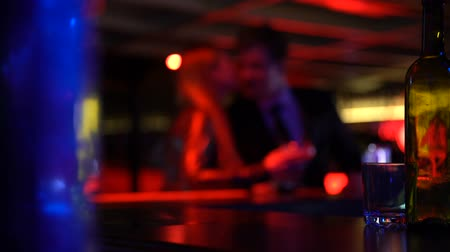 életmód : Happy couple dating in nightclub, woman kissing man in friendly way, defocused Stock mozgókép