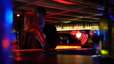 cheat : Unfaithful husband meeting secretly lover woman in nightclub, lie, betrayal Stock Footage