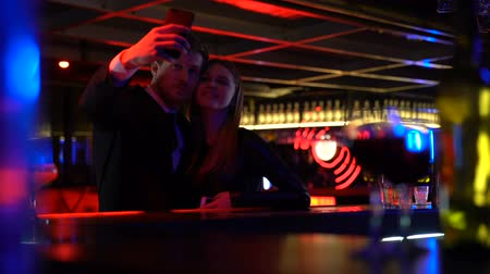時代遅れの : Happy couple taking selfie in bar, having fun together, youth entertainment