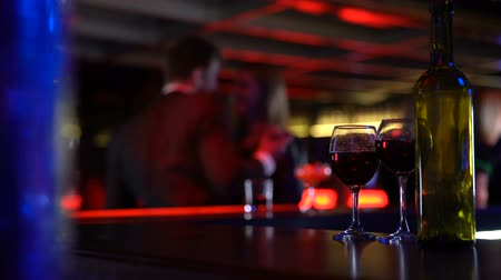 時代遅れの : Couple dancing in club after having glass of wine together, casual acquaintances