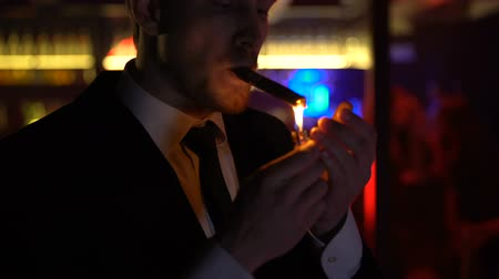cigar : Successful businessman smoking cigar, looking at women in elite strip club Stock Footage