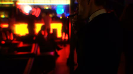 cigar : Drunk businessman smoking cigar at nightclub party, double vision effect Stock Footage