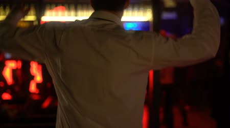 energický : Young male dancing at disco bar, relaxing in night club on weekend, back view