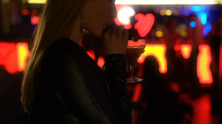 зависать : Nice woman enjoying cocktail at night club, waiting for date at party, closeup