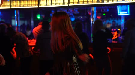 зависать : Attractive young lady dancing at night club, man in suit approaching her, disco
