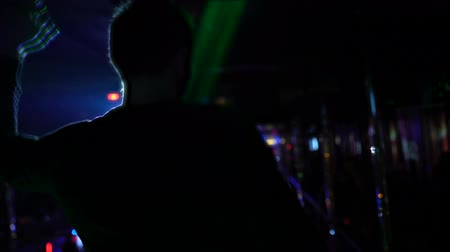 discotheque : Pleased man drinking cocktail and dancing at night club, enjoying nightlife Stock Footage