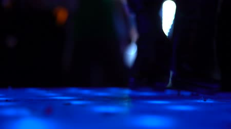 actively : Close-up of female legs with leather shoes moving to party music at night club Stock Footage