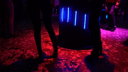 actively : Slim go-go dancers performing on dance floor at night club, nightlife relax