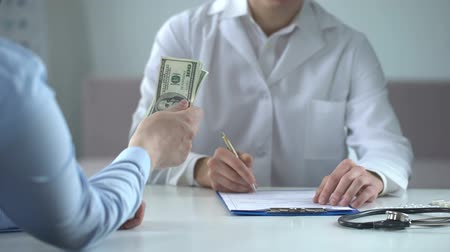 prescribe : Doctor writing fake medical examination, taking bribe, expensive checkups Stock Footage