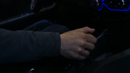 gearstick : Man driving electric car, shifting automatic transmission, modern technologies Stock Footage