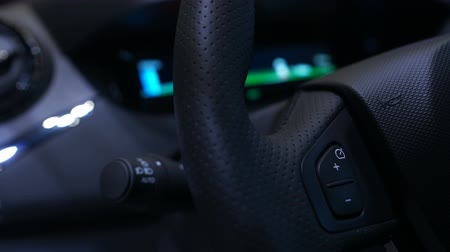 ev : Closeup of dashboard in electric car showing battery charge, plug-in station