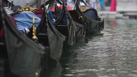 water taxi : Gondolas parked in row, rocking on water, retro taxi for tourists in Venice