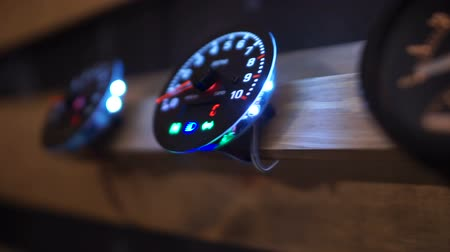 tachometer : Designer speedometers with illumination, motorcycle parts exhibition, upgrade Stock Footage