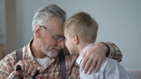 sentiment : Grandpa and grandson leaning foreheads together, family love, sentimentality