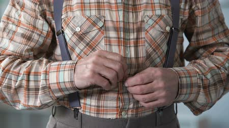 buttoning : Old man buttoning up shirt, suffering from tremor, Alzheimer, senile diseases Stock Footage