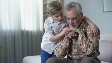 sentiment : Old man sitting upset, feels abandoned, boy consoling him, charity programs