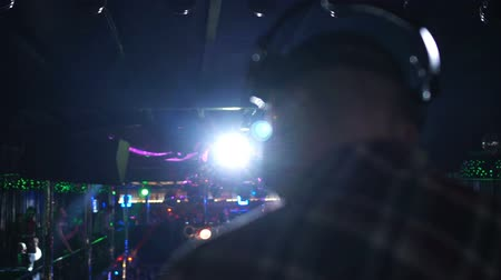 lights up : Disk jockey with headset performing in night club, entertainment, slow-motion Stock Footage