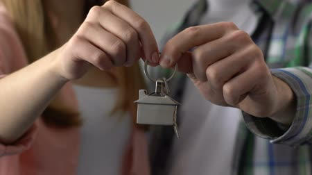 residential area : Couple holding key chain house, buying property, mortgage for young family Stock Footage