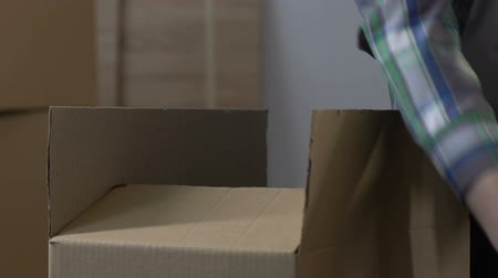 проданный : Man packing stuff into carton, divorce, division of property, moving from house