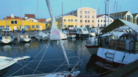 docked : Yachts and sailboats docked in Copenhagen port, summer tourism, European town Stock Footage