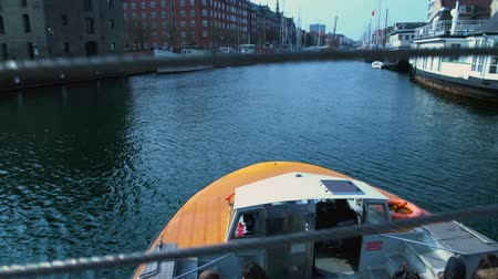 docked : Leisure tourist boat sailing along Nyhavn harbor, travel activity in Copenhagen Stock Footage