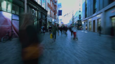 kopenhagen : COPENHAGEN, DENMARK - CIRCA APRIL 2018: People in the city. Crowded area in old Copenhagen town, people walking on pedestrian street, travel