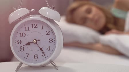deprivation : Healthy sleep of blond woman lying in bed in morning, biorhythms, closeup Stock Footage