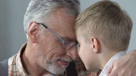 důchodce : Loving grandpa hugging his grandson, family connection, trust relationship Dostupné videozáznamy