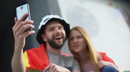 world cup : Spain football fans posing for smartphone selfie on stadium, young generation