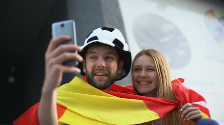 world cup : Spanish football supporters calling via video app to friends from stadium Stock Footage
