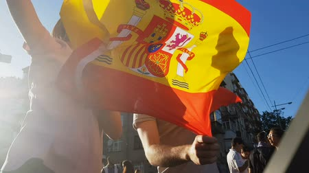 world cup : Spanish fans jumping with flag, celebrating victory of national football team Stock Footage