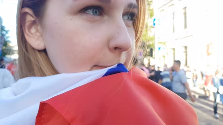 wrapped up : Girl wrapped in national flag upset of defeat, disappointing game of season Stock Footage