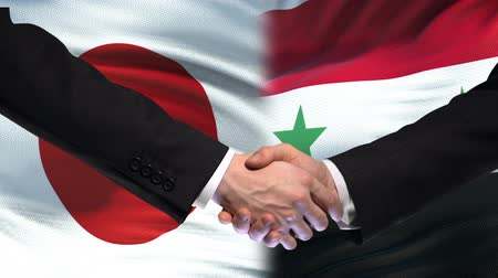 saygı : Japan and Syria handshake, international friendship relations, flag background