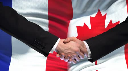 глобализация : France and Canada handshake, international friendship relations, flag background