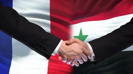 importação : France and Syria handshake, international friendship relations, flag background